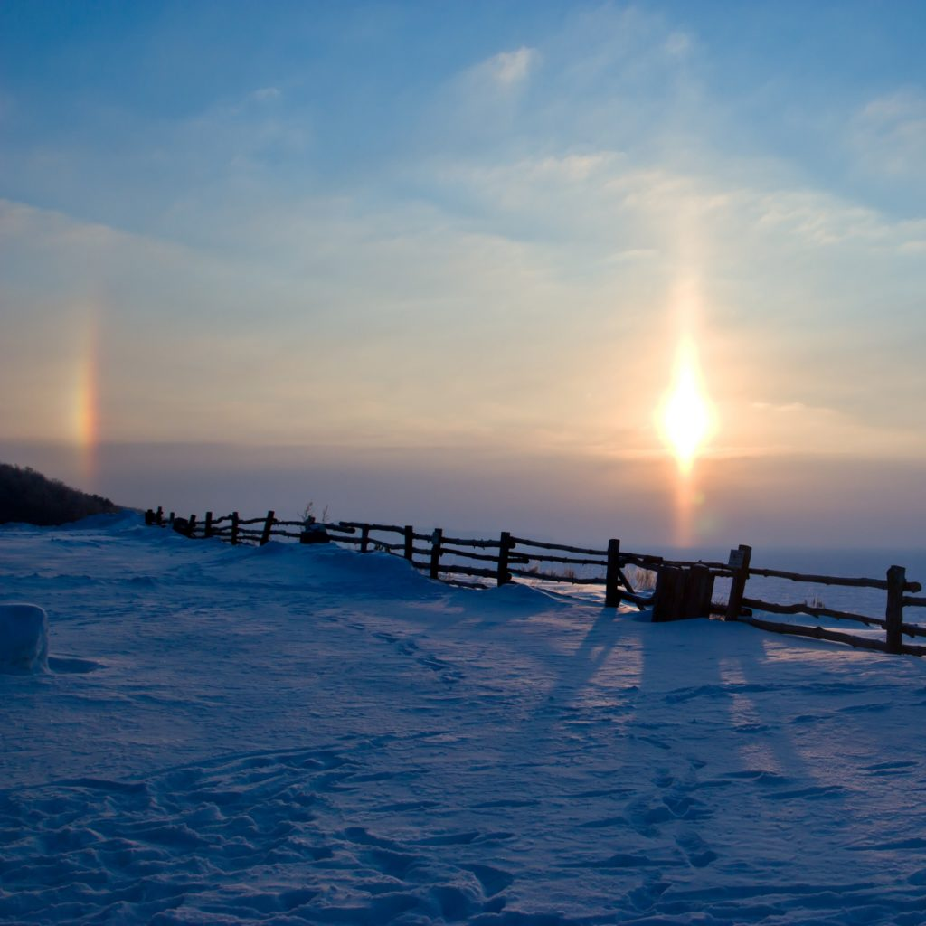 Pargely, false sun, a rainbow in the clouds in winter.